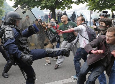 Riot police officers clash with protestors during yesterday's demonstrations.