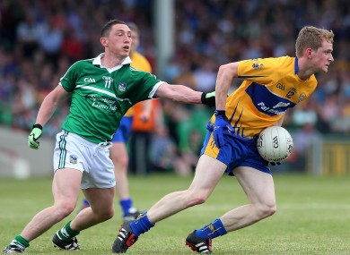 Limerick's Pete Nash in pursuit of Pearse Lillis of Clare.
