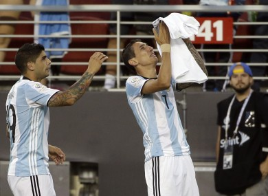 Argentina''s Angel Di Maria, right, holds a t-shirt that reads