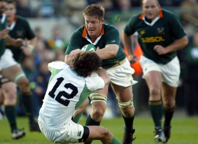 Shane Horgan gets in front of Bakkies Botha at home to the 'Boks in 2004.