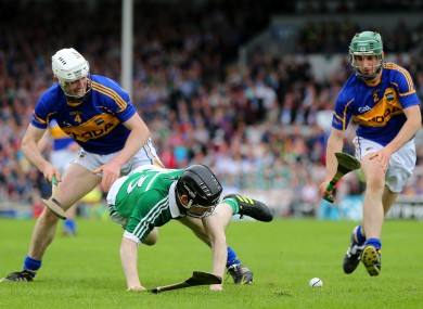 Tipperary duo Michael Cahill and Cathal Barrett with Limerick's Graeme Mulcahy in yesterday's clash in Thurles.