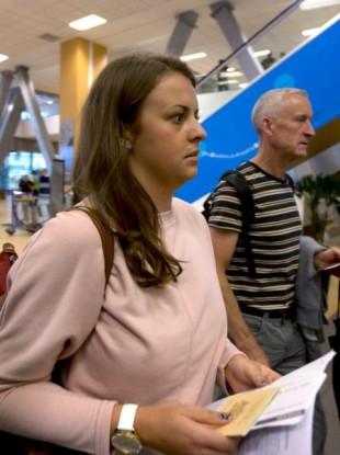 Melissa Reid walks next to her father William Reid before boarding a flight in Lima, Peru, yesterday.