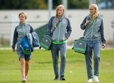 Sue Ronan with players Emma Byrne and Stephanie Roche.