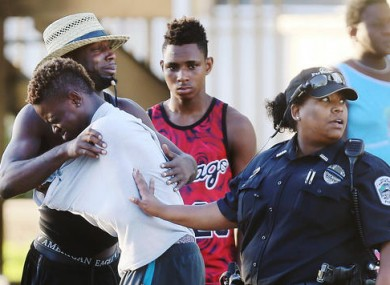 People embrace after the fatal shooting at Club Blu.