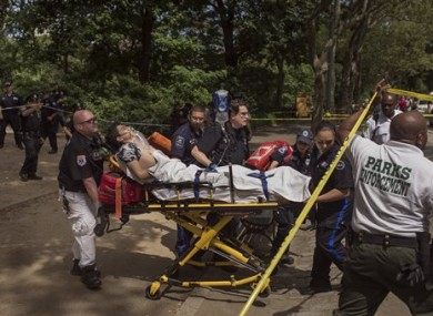 An injured man is carried to an ambulance in Central Park in New York yesterday following an explosion.
