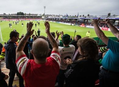 Cork City fans cheer on the team before kick-off last night.