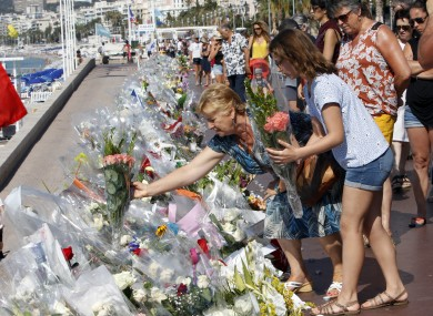 Flowers being placed on the Promenade des Anglais in Nice