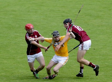 Antrim's Peter McCallin with Jack Canning and Patrick Foley of Galway.