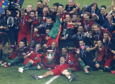 Portugal's Cristiano Ronaldo, centre, and his teammates celebrate with the trophy.