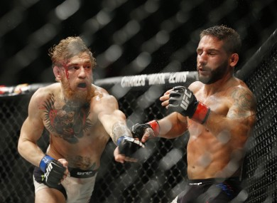 Mendes (right) lost to Conor McGregor at UFC 189.