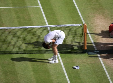 Andy Murray celebrates winning the Men's Singles trophy on day thirteen of the Wimbledon Championships.