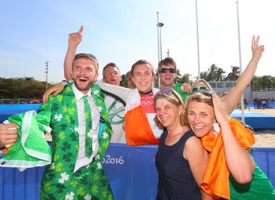 Ireland's Annalise Murphy celebrates winning silver with brother Finn, mother Cathy McAleavey and sister Claudine.