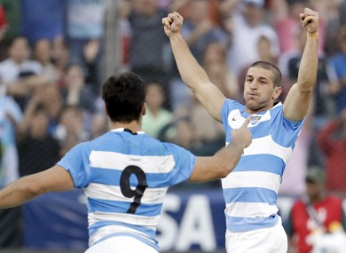 Argentina's Los Pumas Tomas Cubelli, right, and Martin Landajo celebrate after defeating South Africa 26-24.