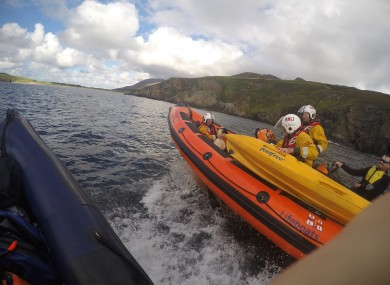 Rescued sheep with RNLI members.