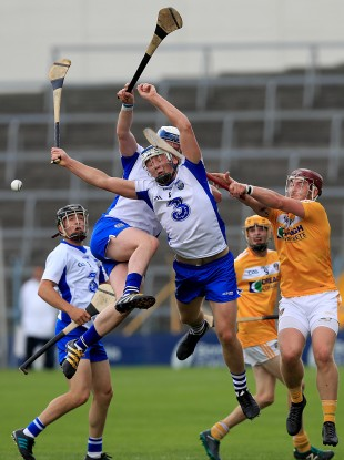 Waterford and Antrim players battle for possession.