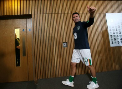 Keane leaves his post-match press conference while being applauded by members of the media.