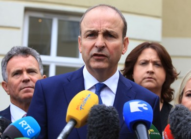 Fianna Fail Leader Micheal Martin speaking to the media with members of his parliamentary party at the start of day one of their think-in.