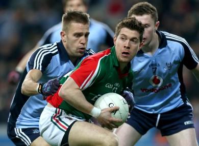 Enda Varley in action against Dublin defenders Johnny Cooper and Jack McCaffrey in 2013.