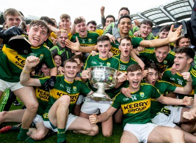 Kerry players celebrate with the cup after the game.