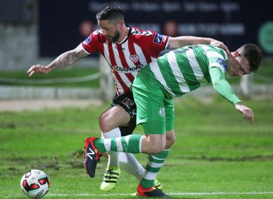 Derry City's Rory Patterson and Sean Heaney of Shamrock Rovers battle for possession.