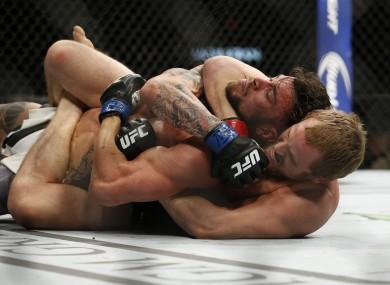Gunnar Nelson submits Brabdon Thatch at UFC 189.