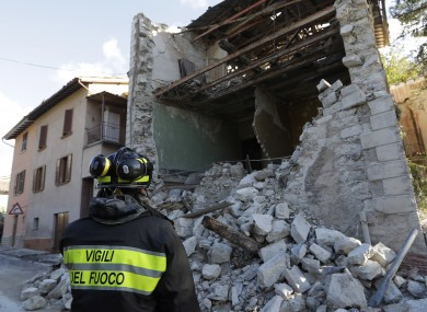 A firefighter looks at a damaged house in the small town of Visso in central Italy, Thursday, Oct 27, 2016, after a 5.9 earthquake destroyed part of the town.