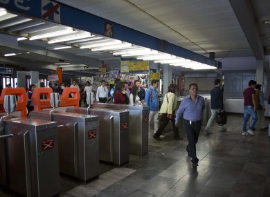 FILE: Passengers enter a metro station in Mexico City