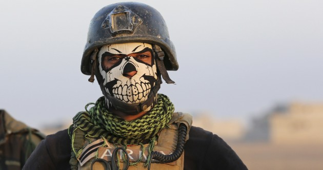 Iraqi forces battle through sniper fire and suicide bombs to retake IS-held city