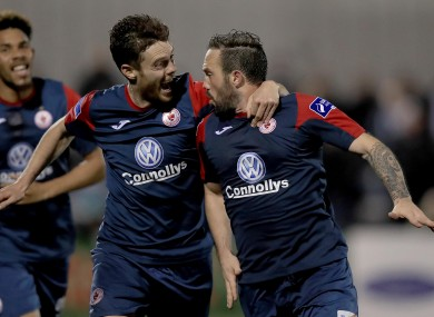 Sligo's Raffaele Cretaro celebrates scoring his side's third goal with John Russell.