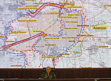 Lt. Gen. Sergei Rudskoi of Russia's military on front of a map of Aleppo.