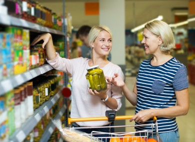 File photo of people shopping for canned goods.