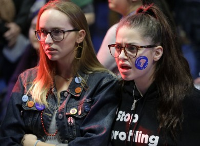 Emma Finnamore, of Maplewood, New Jersey, left, and Rayah Naji, of Boston, right, react while watching televised election returns during a watch party at Wellesley College.
