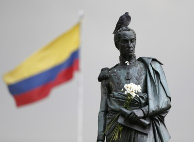 Flowers decorate the statue of independence hero Simon Bolivar in downtown Bogota, Colombia, in the days after President Juan Manuel Santos won the Nobel Peace Prize following the voters' narrow rejection of a peace deal with FARC.