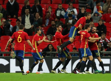 Spain celebrate their late equaliser.
