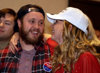 Republican supporters embrace as they watch election returns for Donald Trump at the Colorado Republican election night party.