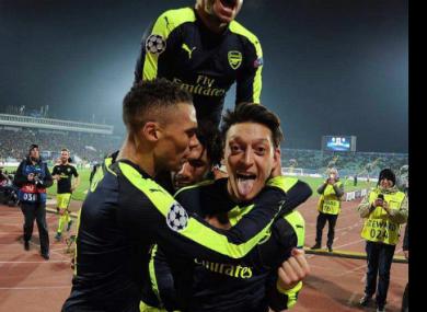 Mesut Ozil celebrates his late winner.