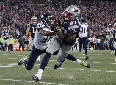 New England Patriots tight end Rob Gronkowski (87) catches a pass in front of Seattle Seahawks cornerback DeShawn Shead (35) during the second half.