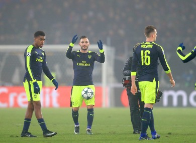 Perez (centre) and the Arsenal players at full-time.