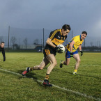 Brian Looney just stays on the pitch as Dr Crokes go on to defeat The Nire.<span class=