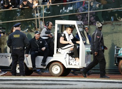Oakland Raiders quarterback Derek Carr (4) is taken off the field in a cart during the second half of an NFL football game against the Indianapolis Colts.