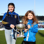 Lucy Quinn and Kate Finnegan with the main prize in Parnell Park before throw-in.<span class=