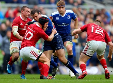 Munster's Tyler Bleyendaal attempts to stop Robbie Henshaw in his tracks.