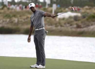 Tiger Woods reacts after hitting on the 16th hole during the third round at the Hero World Challenge golf tournament.