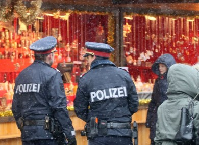 Police patrol a Christmas market in downtown Vienna, Austria last month