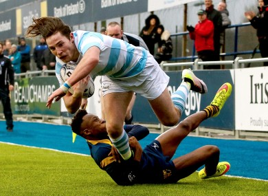 Tom Roche goes over for one of Blackrock's seven tries.