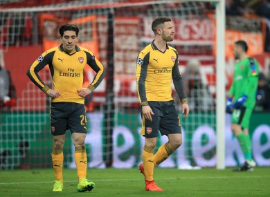 Arsenal's Shkodran Mustafi (right) and Arsenal's Hector Bellerin (left) appear dejected after Bayern Munich's Robert Lewandoski (not in picture) scores his side's second goal of the game.