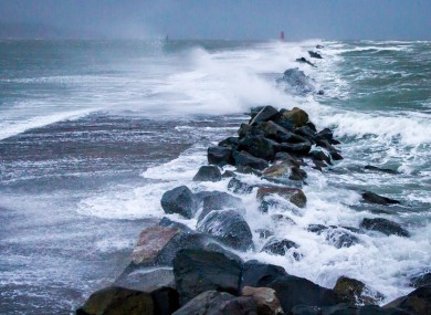 Waves breaking over the Great South Wall at Poolbeg in Co. Dublin.