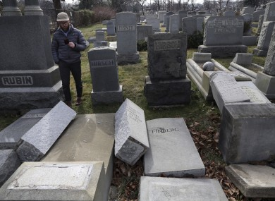 Rabbi Joshua Bolton surveys the damaged headstones in Philadelphia