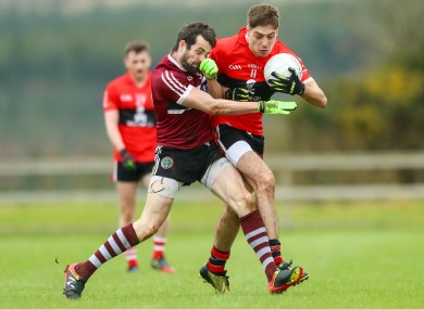 St Mary's Kevin McKernan and UCC's Adrian Spillane.