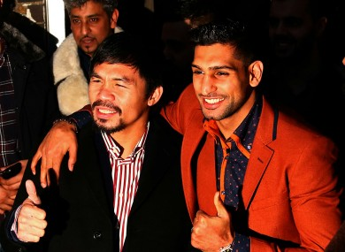 Manny Pacquiao and Amir Khan pose as they negotiate a potential welterweight bout